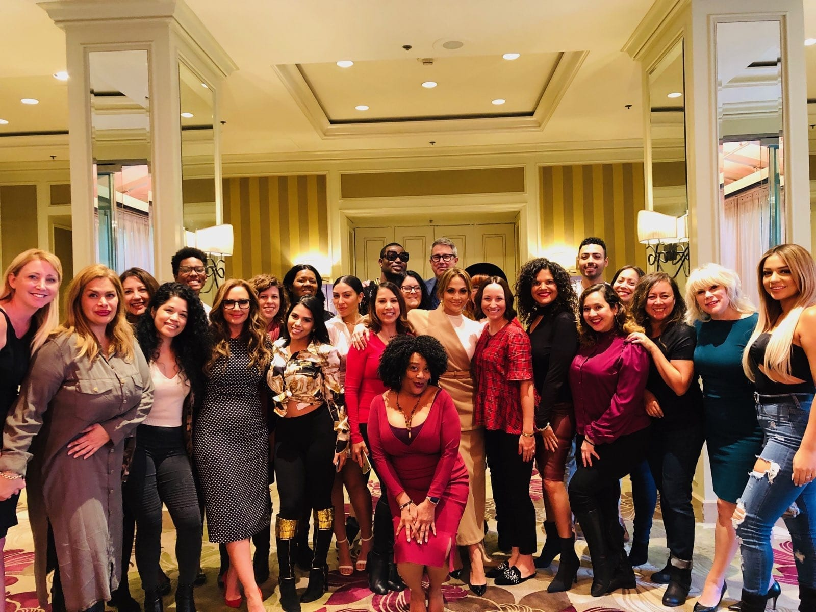 Jennifer Lopez with arm around Michelle Rivera of Michelle Rivera Lifestyle at Press Junket. Leah Remini in front far left side.